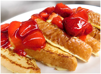 Delicious strawberry french toast at Downers Delight Restaurant in Downers Grove